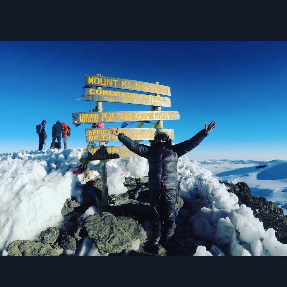 Dr. Jenhangir atop Mount Kilimanjaro